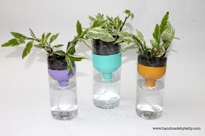 Recycled self watering water bottle garden craft for Recycled water bottle crafts for kids